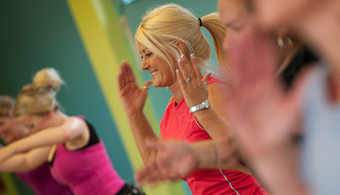 woman at ymca exercise class