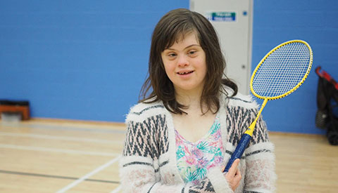 girl with badminton racket at ymca