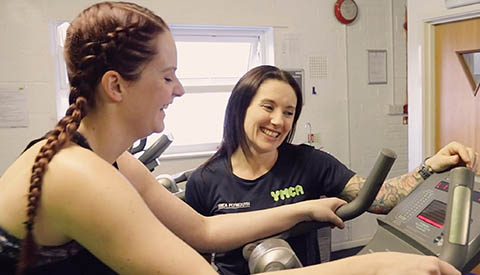 woman doing cardio workout with personal trainer at YMCA Plymouth gym